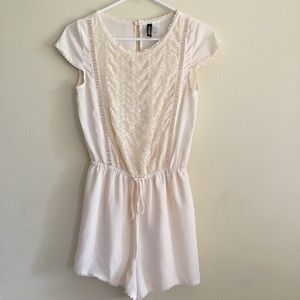 Romper with intricate flower detailing